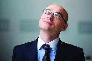 Bald businessman, wearing eyeglasses